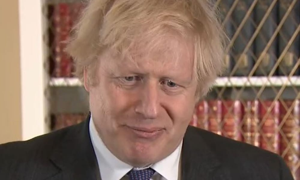 Boris Johnson squirms in a suit
