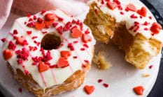 The love nut Yumnut, a croissant-doughnut covered in white icing and red hearts