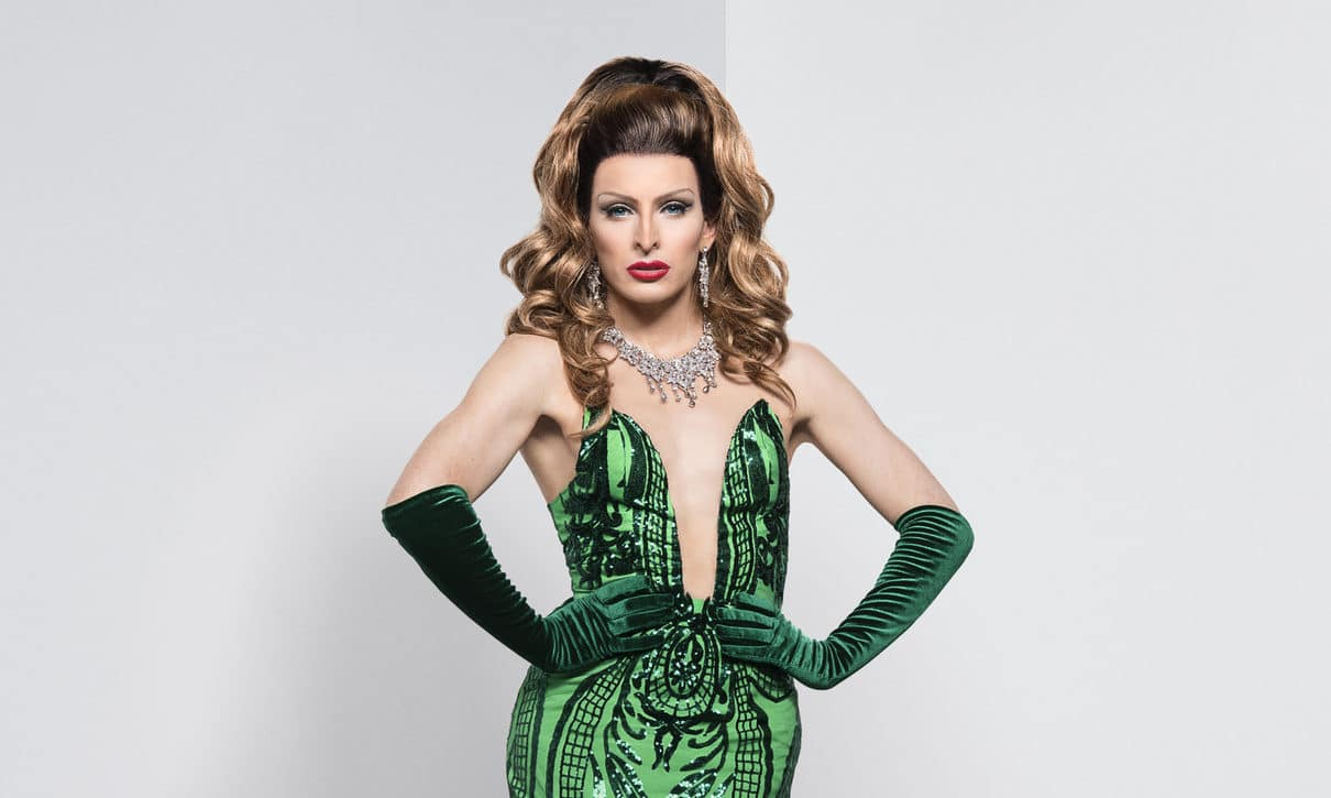 Veronica Green in a plunging green dress, matching gloves