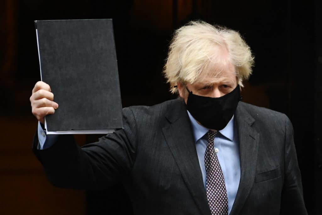British prime minister Boris Johnson leaves Downing Street on his way to the House of Commons to deliver a statement on the governments four-step plans to release England from the current lockdown