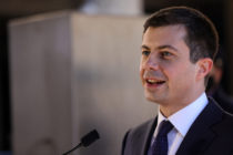 Secretary of transportation Pete Buttigieg speaks in front of a podium