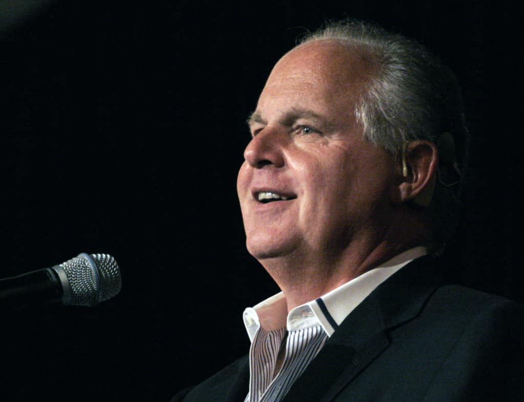 Rush Limbaugh speaks into a microphone