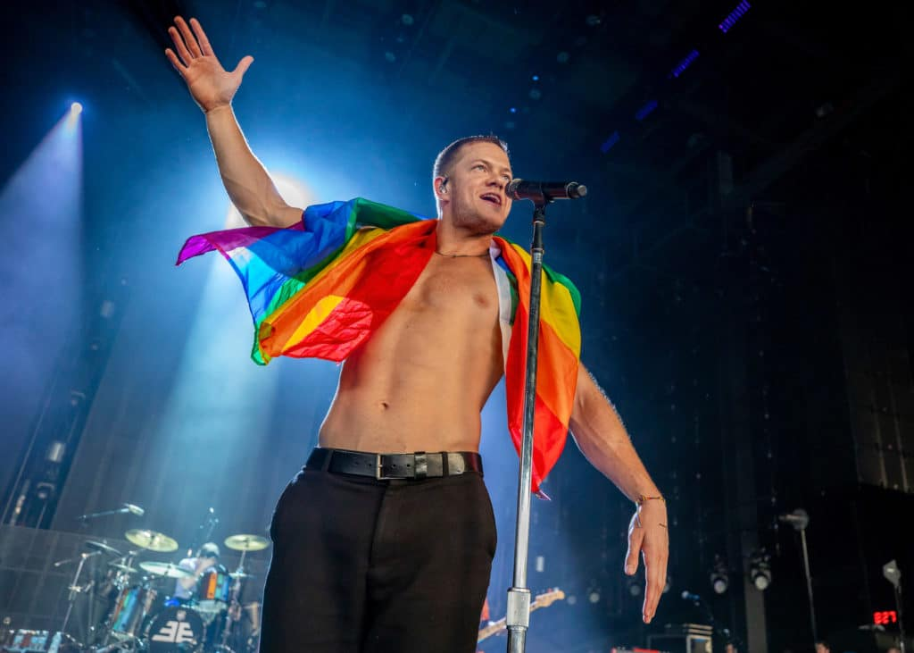 Dan Reynolds of Imagine Dragons holds a gay pride flag