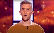 Calum Scott Howells singing on a reality TV show stage