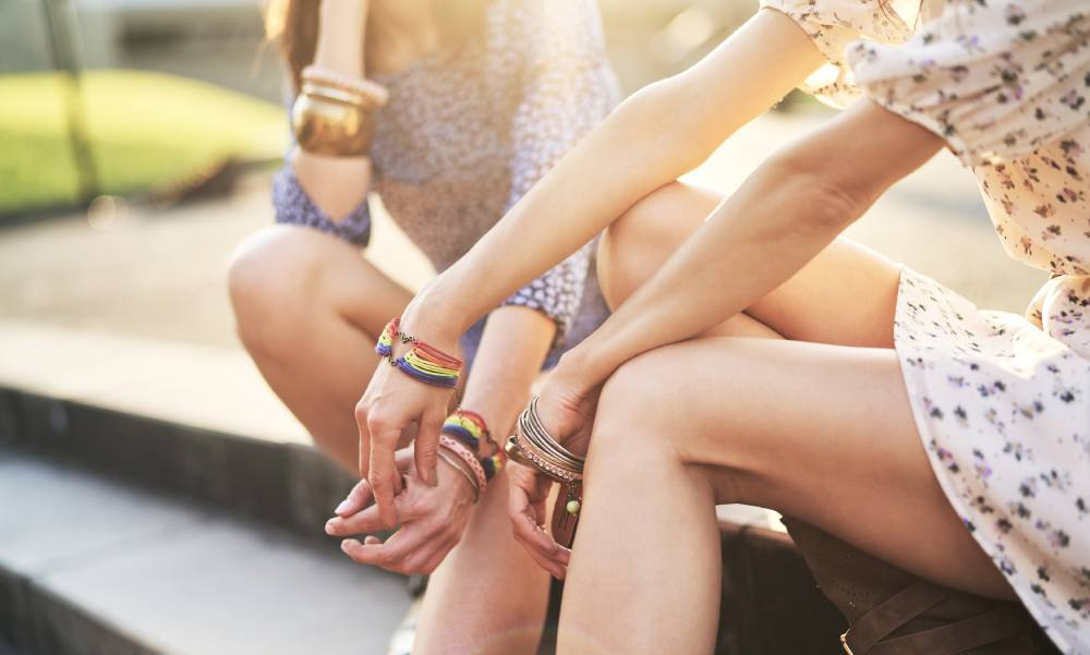 two teens holding hands