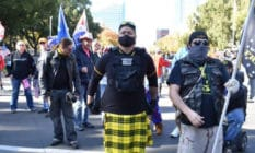 A man identified by social media sleuths as police officer Rick Fitzgerald attending a Proud Boys event
