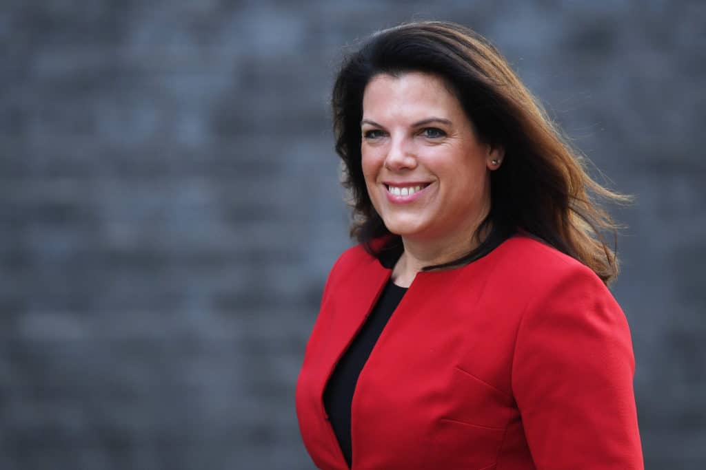 Caroline Nokes arrives at Downing Street in a red suit