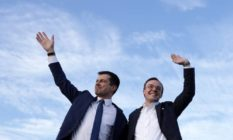 Pete and Chasten Buttigieg waving