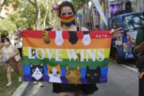 A foreign resident in Taiwan displays a rainbow flag at Taipei 2020 LGBT+ Pride