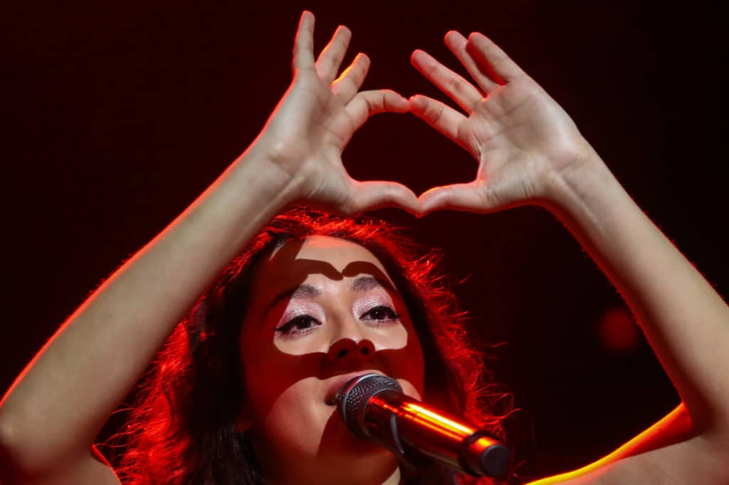 Manizha Sangin makes a heart-shape with her hands