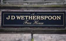 A close up of a Wetherspoons pub sign