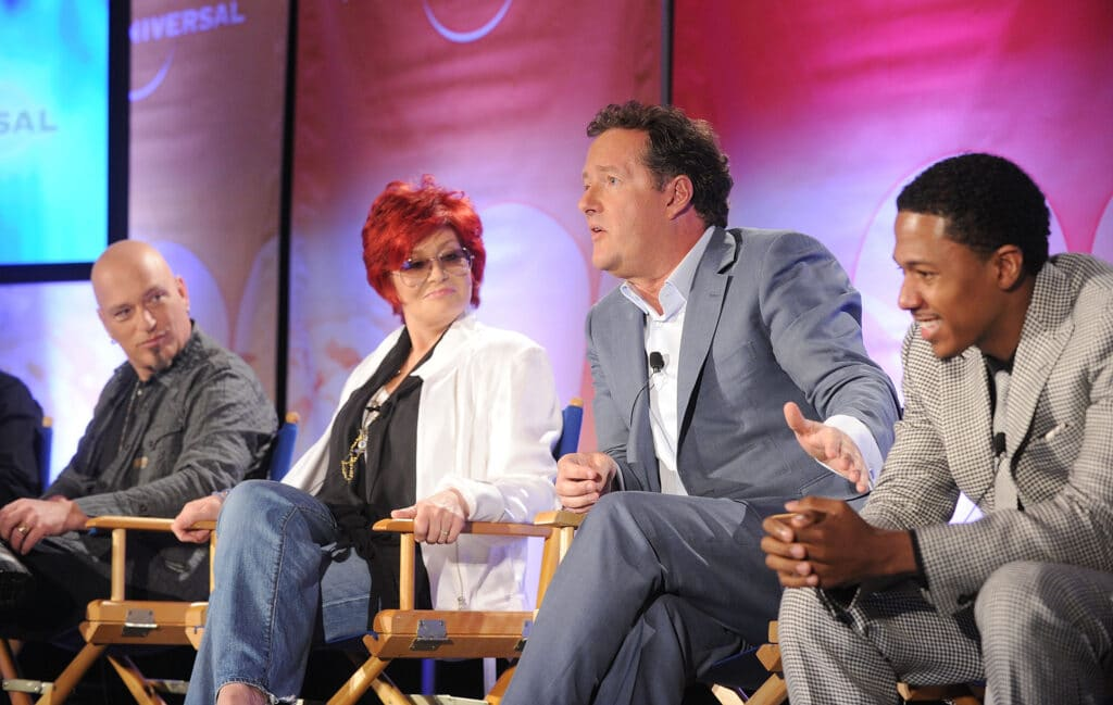 Sharon Osbourne and Piers Morgan talk on a panel