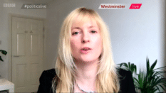 Rosie Duffield speaking via video uplink against a white room