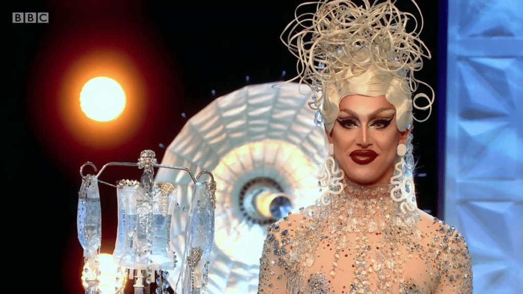 A'Whora, a drag queen, in a silver medusa-like headpiece and see-through jewelled dress