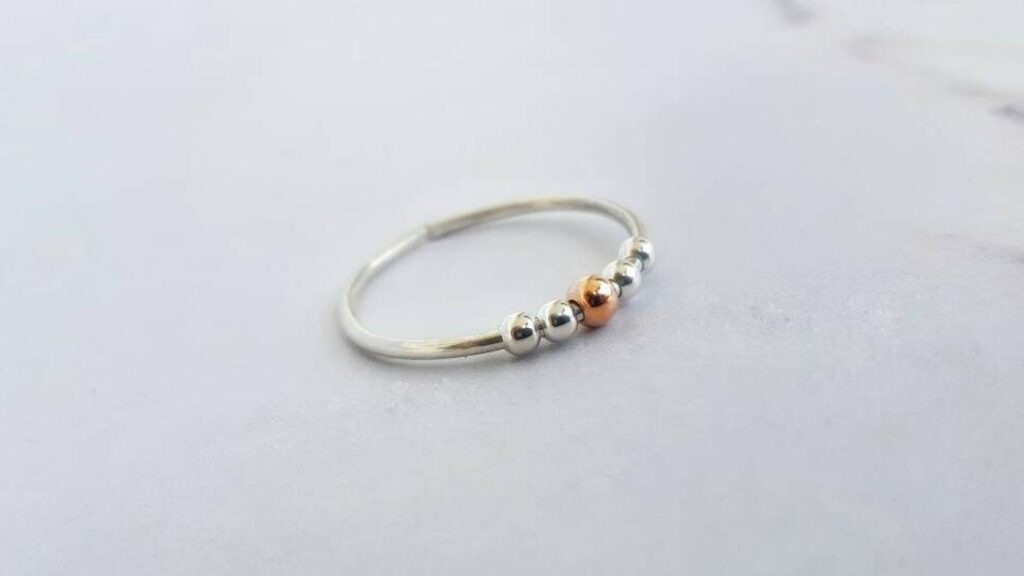 This ring comes with beads to help with anxiety and stress. (INNOCENTIJEWELRY)