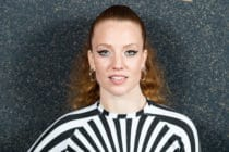 Jess Glynne wearing a black and white dress