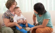 lesbian mothers playing with child