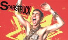 "Olly Alexander on the Years & Years ""Starstruck"" cover, wearing a gold vest and heavy chains"