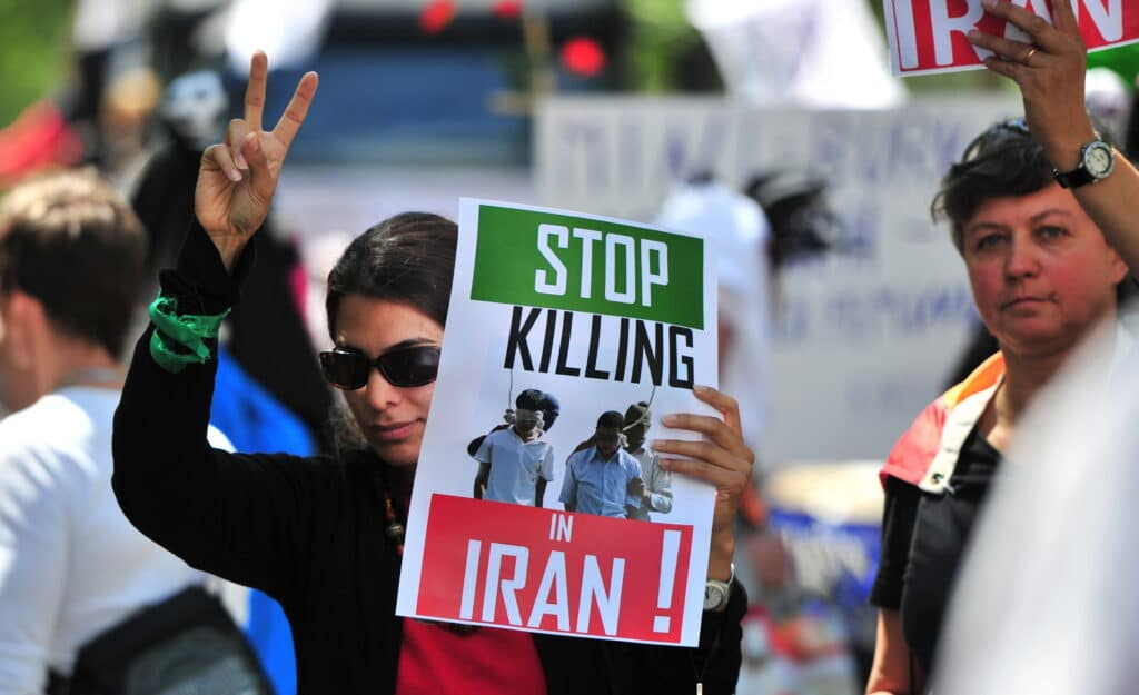 Women demonstrate against the situation in Iran during the Christopher Street Day (CSD) LGBT+ Pride