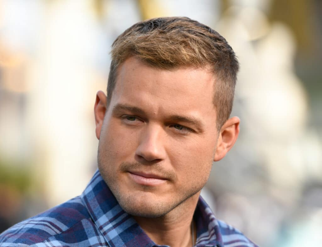 Colton Underwood pensively stares to his right