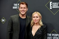 Colton Underwood (L) and Cassie Randolph pose together on the red carpet