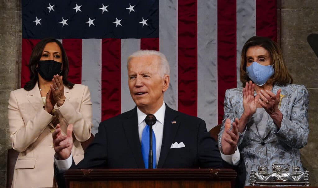 President Joe Biden addresses a joint session of Congress, with vice president Kamala Harris (L) and House speaker Nancy Pelosi (R) on the dais