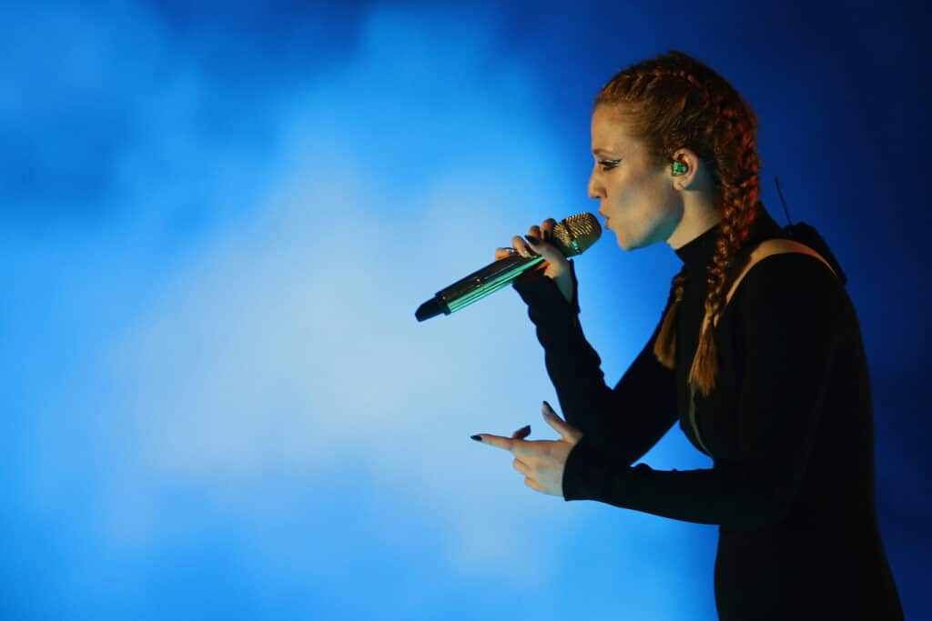 Jess Glynne sings into the microphone