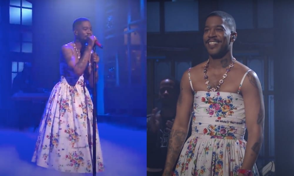 Kid Cudi performs on-stage in a white floral dress