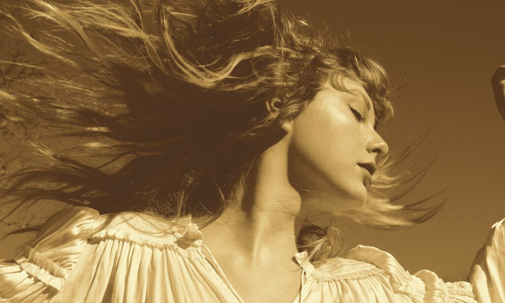 Taylor Swift on the Fearless (Taylor's Version) cover, looking to the right with her hair swept up in the wind