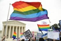 Demonstrators wave LGBT+ Pride flags outside the US Supreme Court