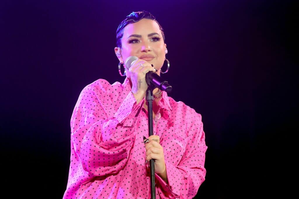 Demi Lovato performs onstage during the OBB Premiere Event in a pink dress