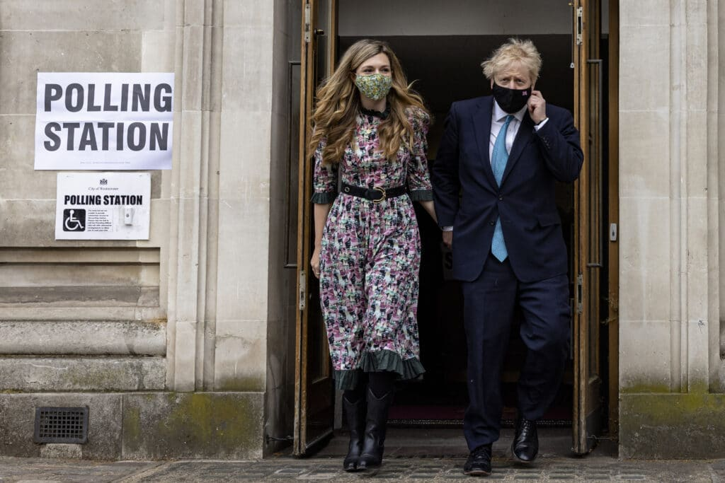 Prime minister Boris Johnson and his fiancée Carrie Symonds leave Methodist Central Hall in Westminster