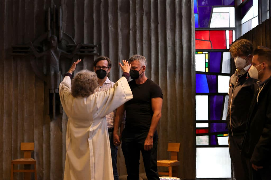 Brigitte Schmidt, a pastoral worker blesses a same-sex couple, Ralf Michael Berger and Andreas Helfrich, at the Catholic St. Johannes XXIII church on May 10, 2021 in Cologne, Germany.