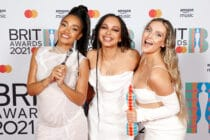 Leigh-Anne Pinnock, Jade Thirlwall and Perrie Edwards pose with their British Group award in the media room during The BRIT Awards 2021