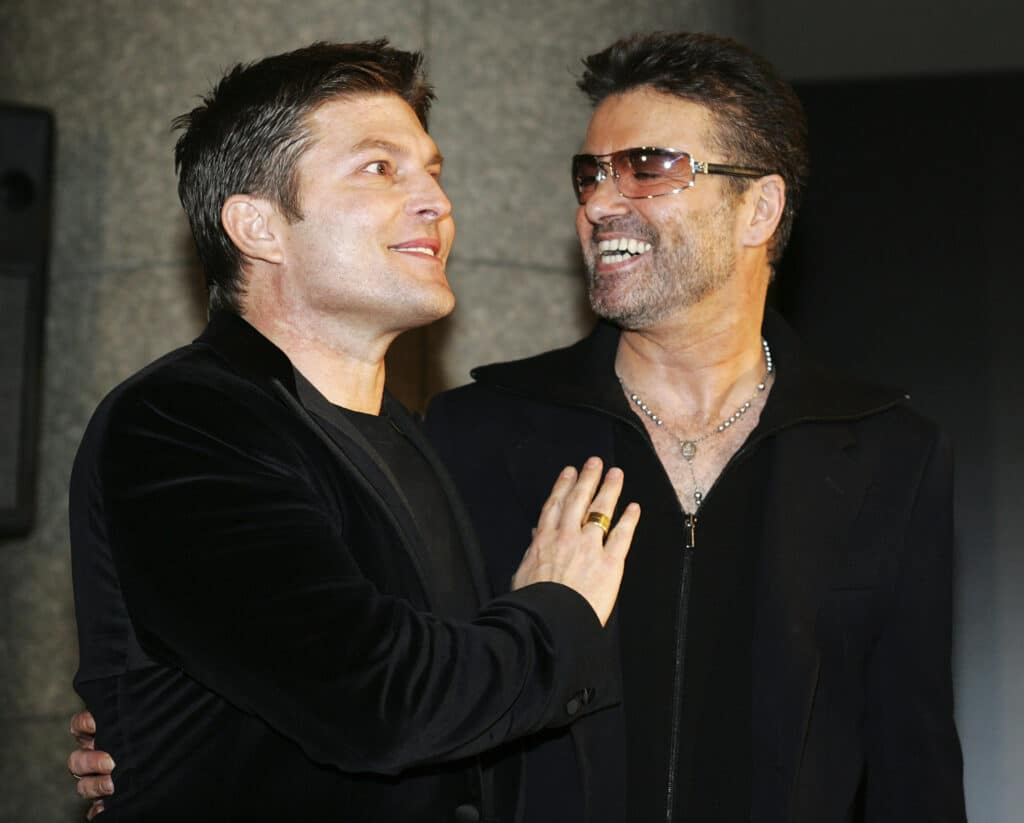 The late George Michael and his partner Kenny Goss a