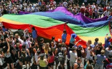 The Rainbow flag, a symbol of gay pride is paraded down Fitzroy Street