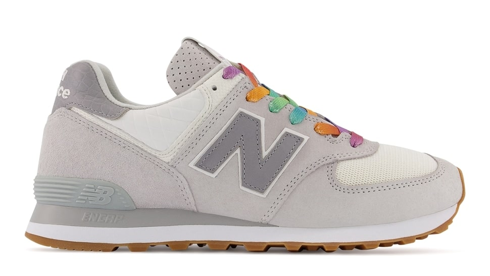 The grey trainers feature a pop of colour with the rainbow laces. (New Balance)