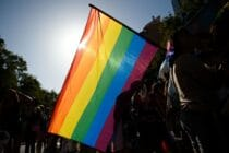 Participants wave a rainbow flag during the 2019 Gay Pride parade in Barcelona