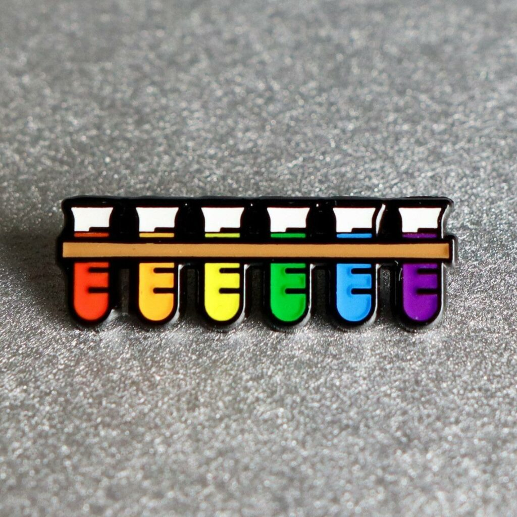 A test tube rack featuring the Pride colours. (ProudScience)
