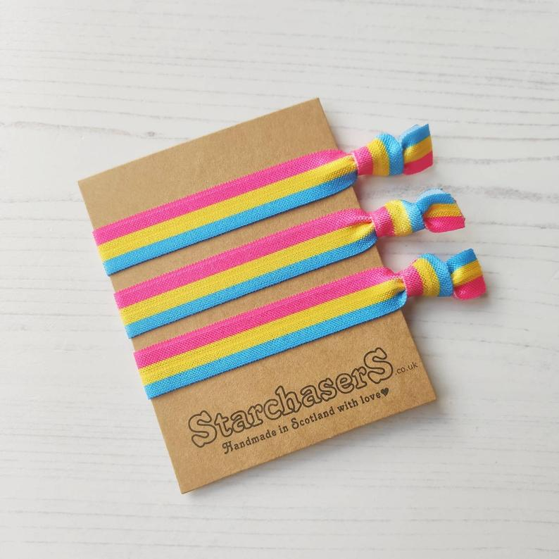 A wrist band and hair tie featuring the colours of the flag. (StarchasersUK)