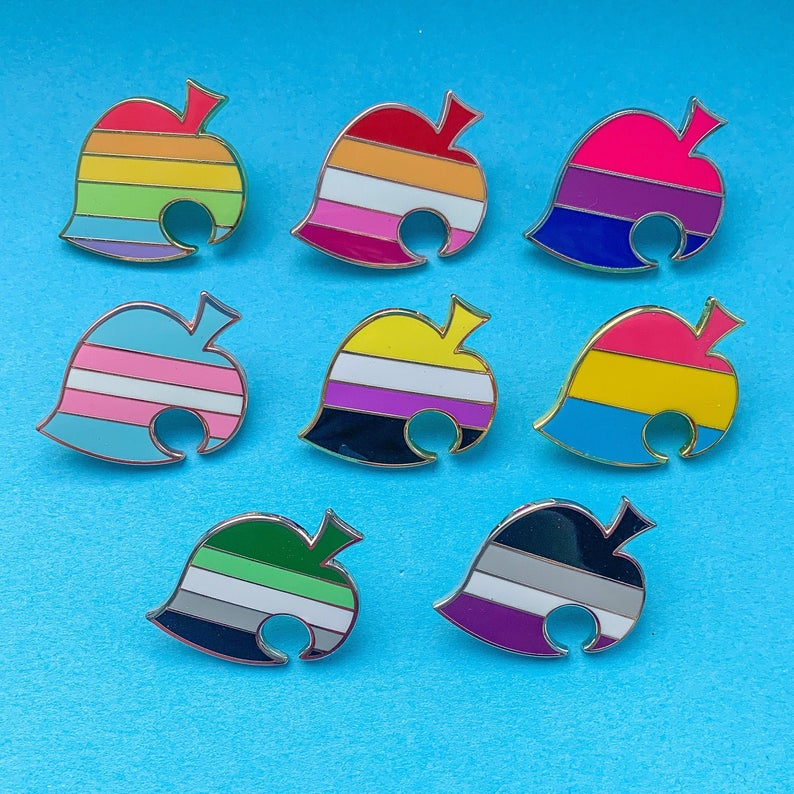 A collection of Animal Crossing themed pride pins. (teasuii)