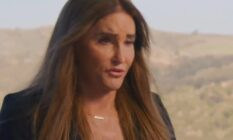 Caitlyn Jenner, with the dry Californian landscape behind her, speaks off to a camera facing her left