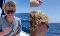 Milo Yiannopoulos with a blonde perm and sunglasses throwing a ring out of a boat and into the ocean
