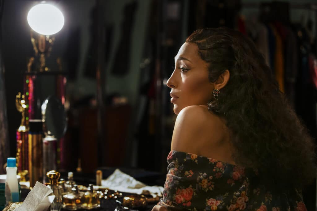 Mj Rodriguez as Blanca, staring into a vanity mirror