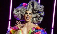 Alyssa Edwards in a huge, sculpted silver wig and rainbow-coloured dress