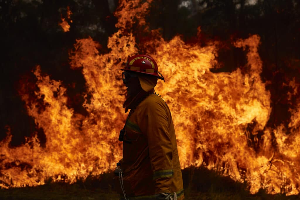 A CFA Member works on controlled back burns