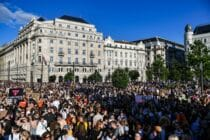 thousands protest outside Hungary's parliament against a bill which has now passed, banning the mention of LGBT+ people in schools