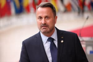 Prime minister of Luxembourg Xavier Bettel speaks to press members as he arrives for the first day of European Union (EU) Summit
