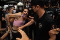 A protester is detained by police the Pride march in Istanbul on 26 June, 2021