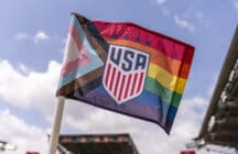 A corner flag with the Pride flag printed on it sits on the field during a training session at BBVA Stadium on June 9, 2021 in Houston, Texas